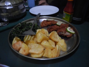 An amazing dinner of spinach, roast potatoes and fried fish.